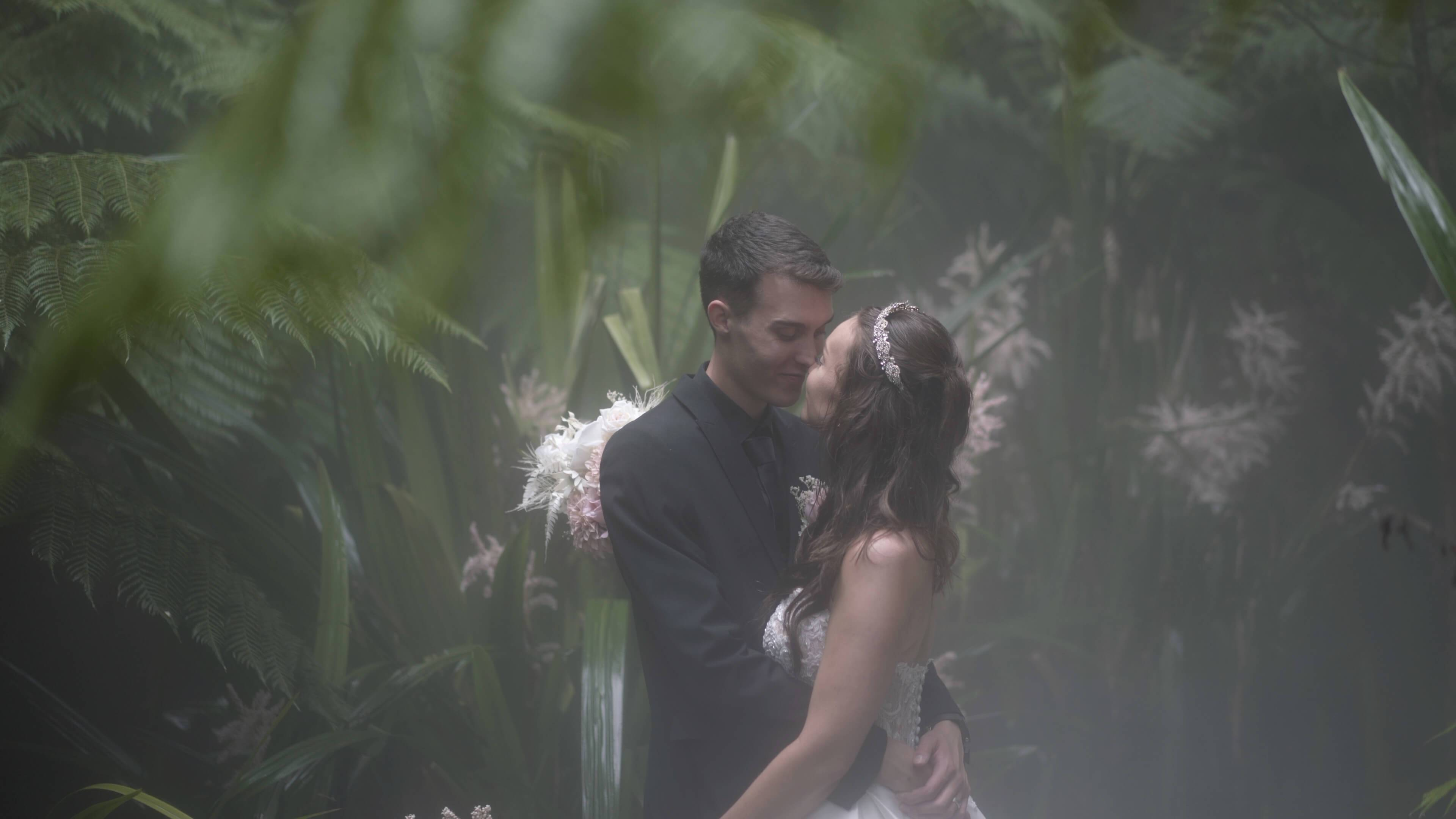 Newly married couple posing in a misty forest - wedding videography services in Canberra and surrounding areas - Lovereel