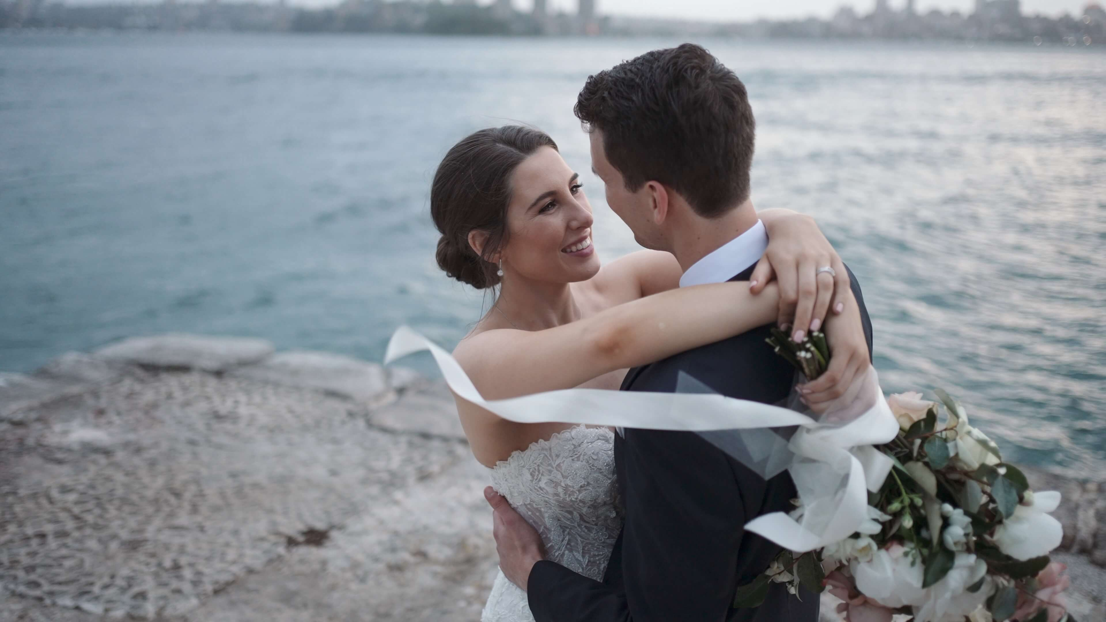 Newly married couple dancing on a pier - wedding videography services in Sydney and surrounding areas - Lovereel